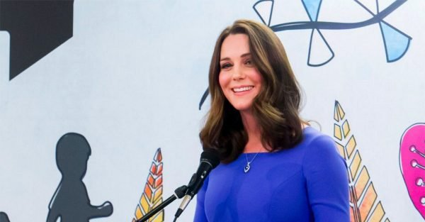 Kate Middleton donated how much of her hair to charity?