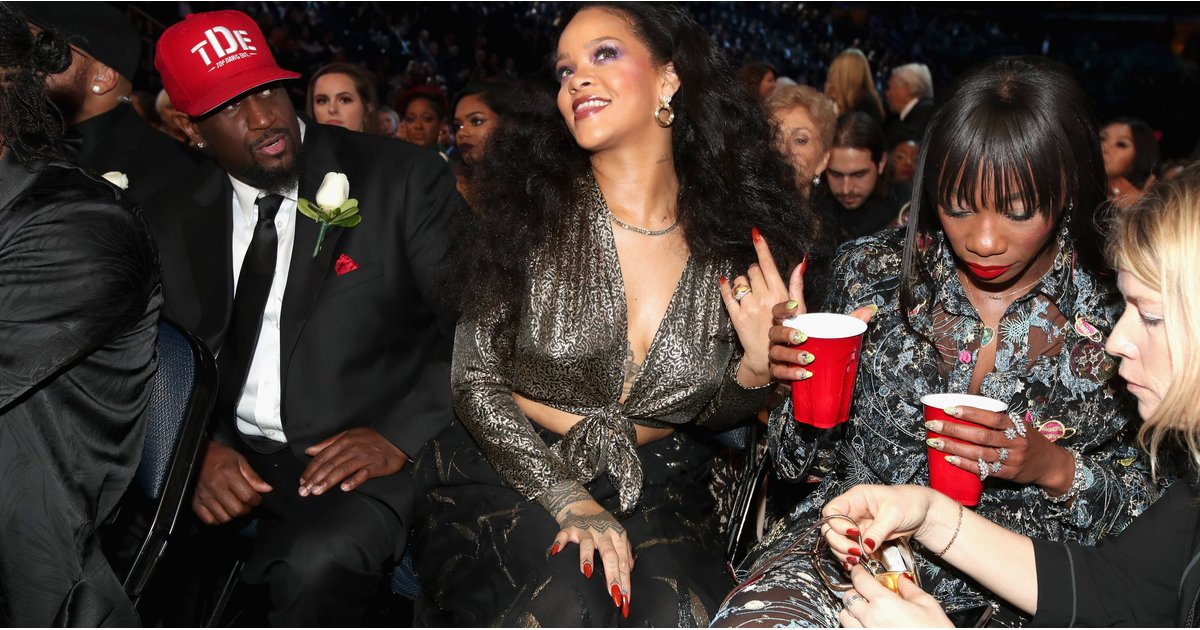 """Rihanna Basically Told Her Best Friend, """"Hold My Drink,"""" While She Posed For Pictures"""