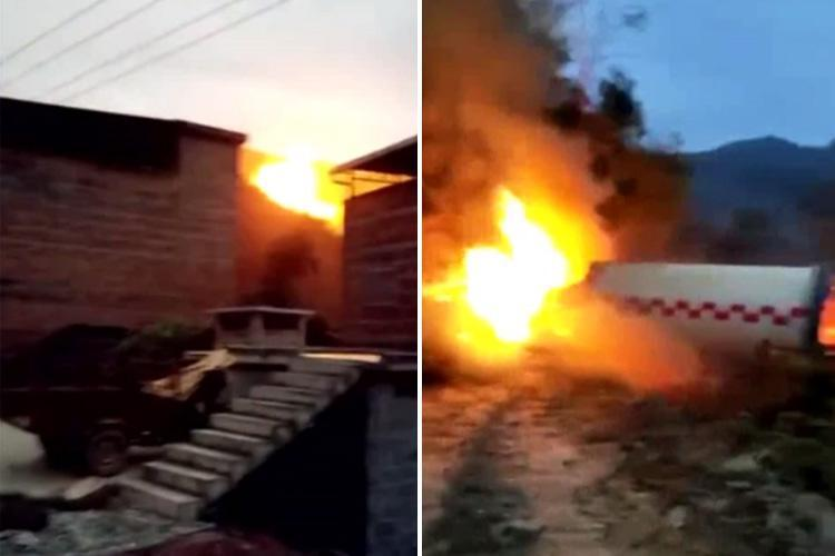 Incredible moment debris from Chinese space rocket explodes into flames near houses after crashing back down to Earth