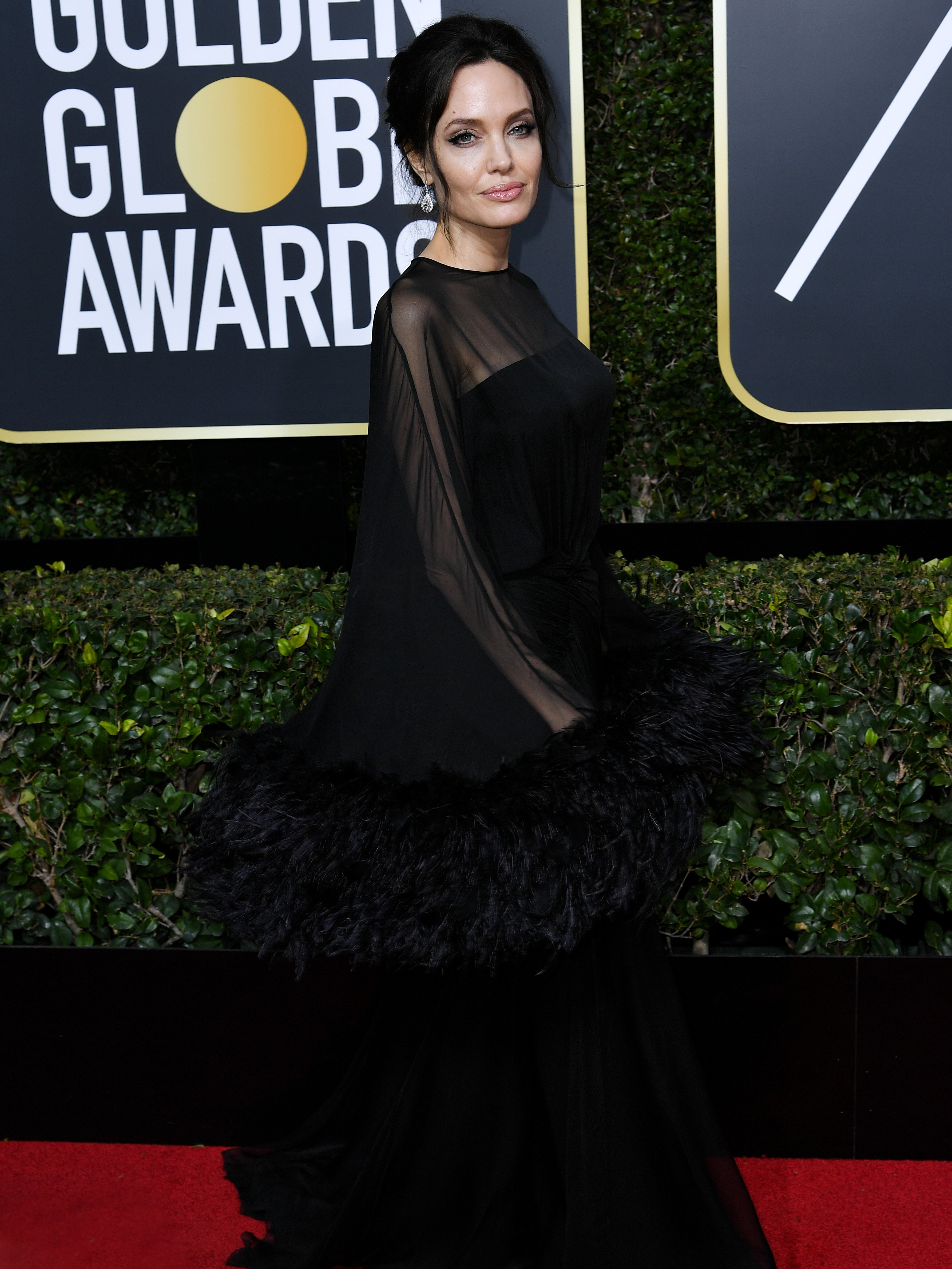 Angelina Jolie arrives at Golden Globes 2018 with unexpected date