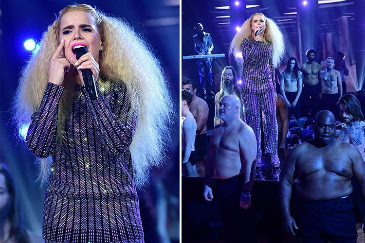 Paloma Faith confuses Brit Awards nominations party viewers as she sings surrounded by shirtless crying men