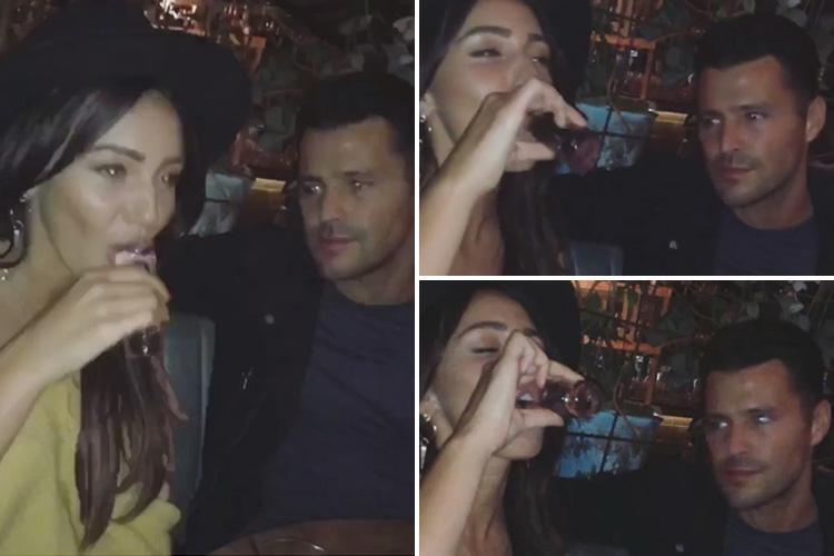 Michelle Keegan downs shots with Mark Wright as couple ring in the new year