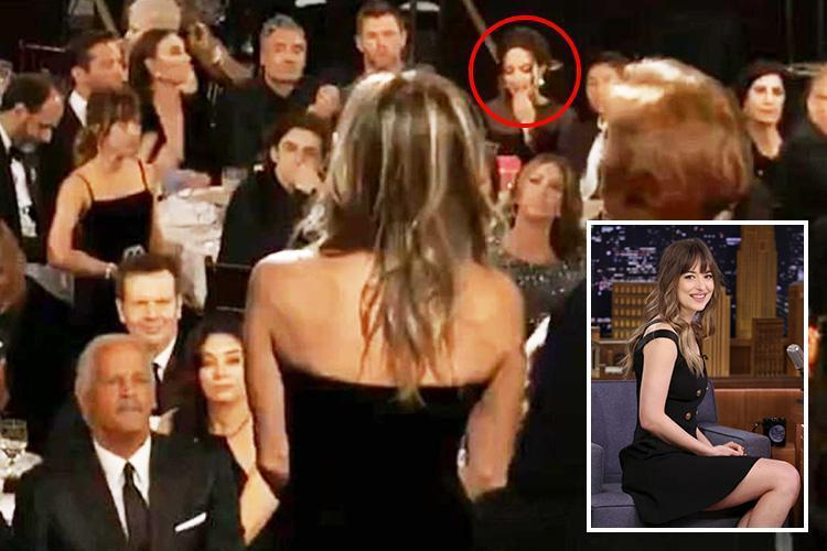 Dakota Johnson denies she was staring at Angelina Jolie during Jennifer Aniston's Golden Globes speech after her side-eye was caught on camera