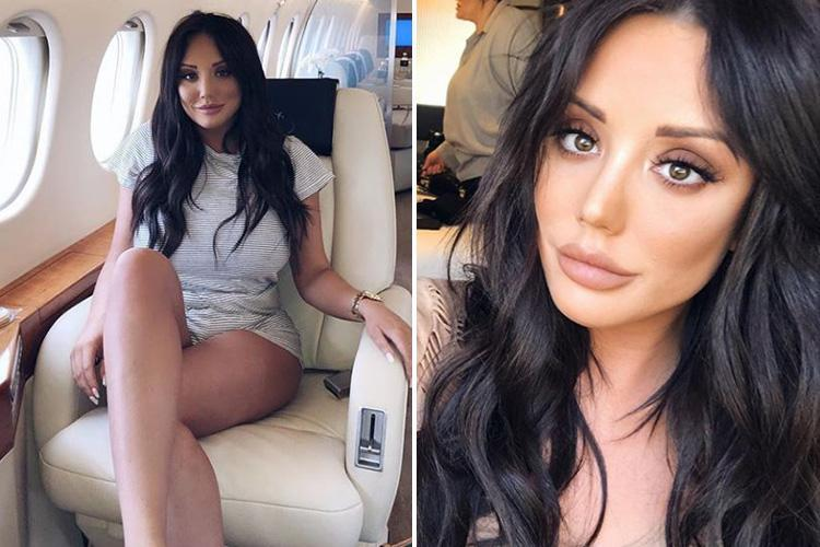 Charlotte Crosby flashes her long legs on a private jet during tour of Australia
