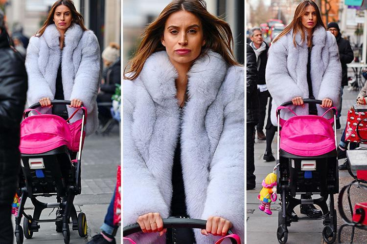 Ferne McCann battles the bad weather as she takes baby Sunday for a posh lunch at The Ivy