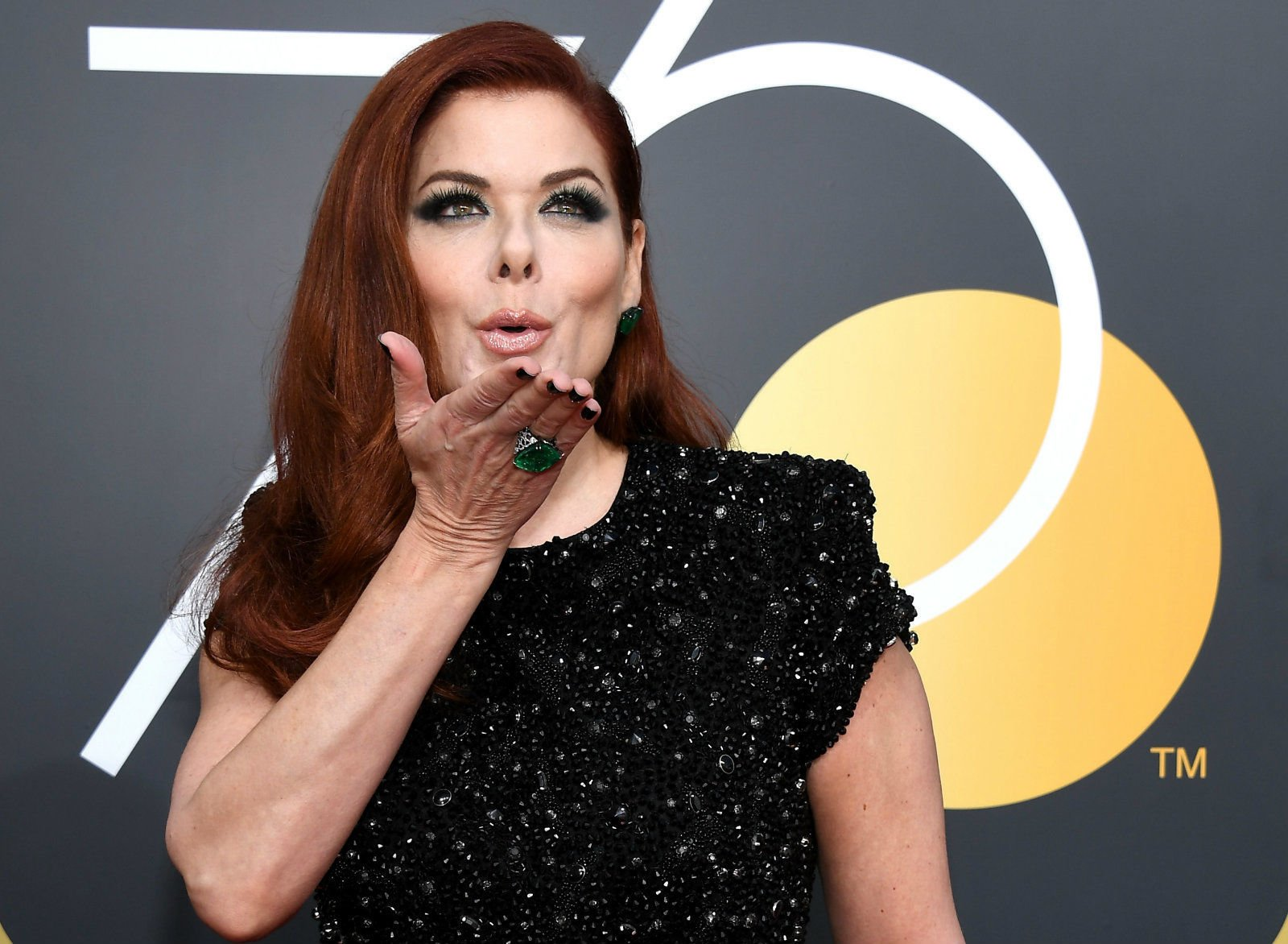 Will & Grace star Debra Messing calls out E! over gender pay gap during an interview with E!