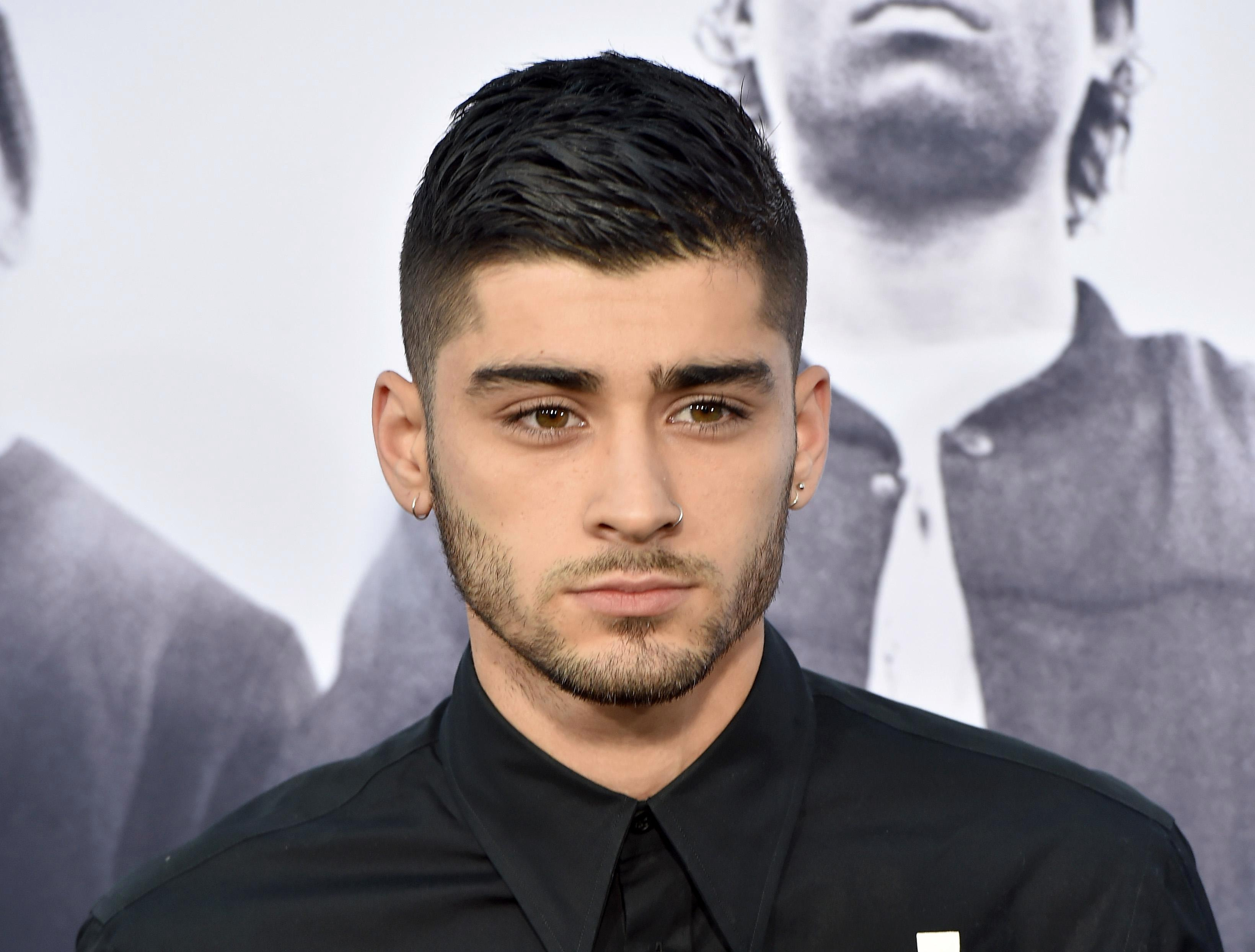 How old is Zayn Malik, why did he go bald, what's his net worth and how long has he been dating girlfriend Gigi Hadid?
