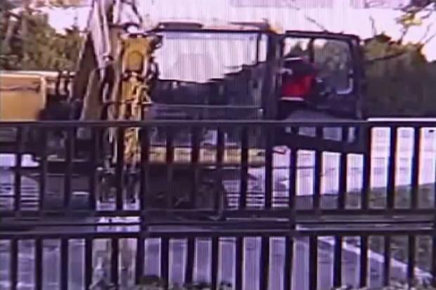 Mischievous schoolboy goes on JCB rampage after climbing into digger and destroying iron gate