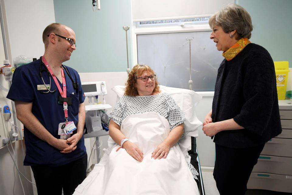 Theresa May apologises over cancelled NHS operations as Jeremy Hunt appears to admit hospitals are in a 'winter crisis'