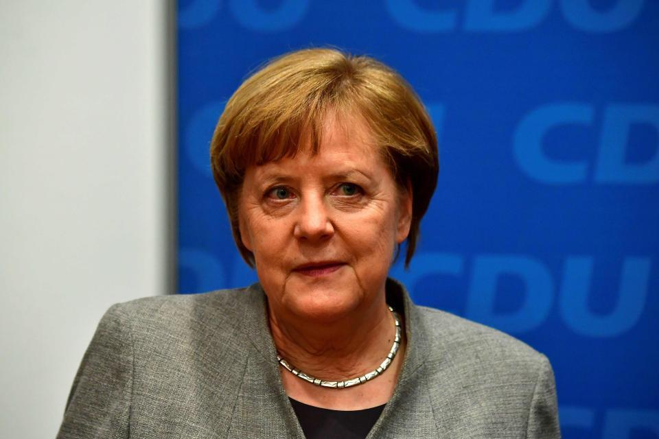 Angela Merkel's conservatives enters 'grand coalition' with Germany's centre-left SPD