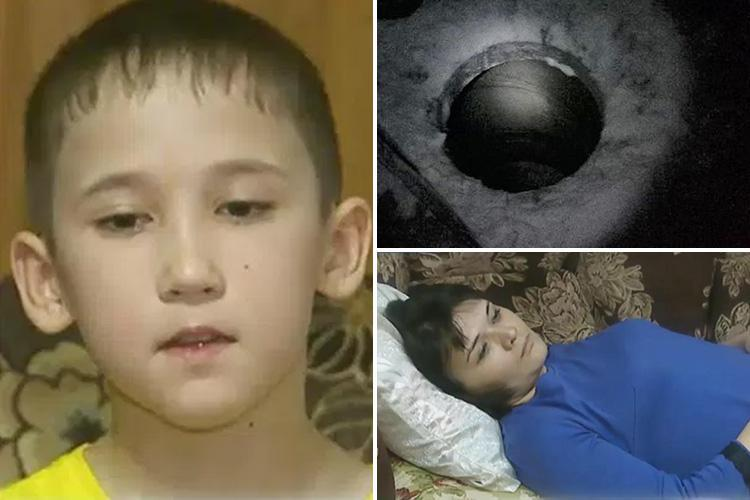 Russian woman trips and falls down a sewer during a blizzard only to find a missing 10-year-old boy was already stuck down there