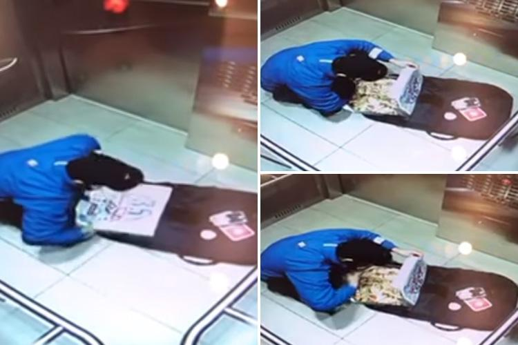 Cheeky Domino's delivery driver caught on camera eating toppings off customer's pizza while on his way to drop it off