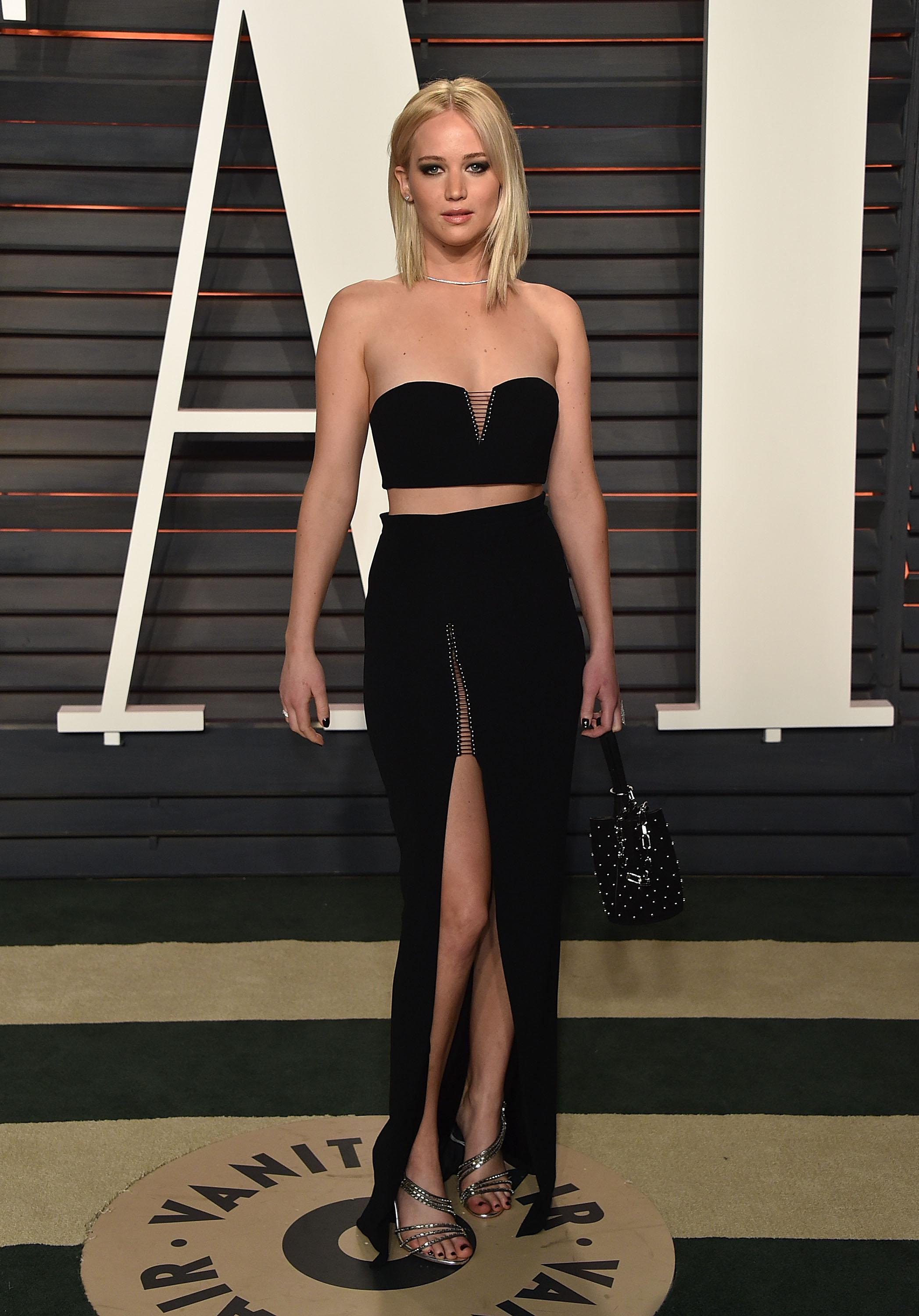 What is Jennifer Lawrence's net worth, what are her biggest films, has she split from Darren Aronofsky and what was the naked picture leak?
