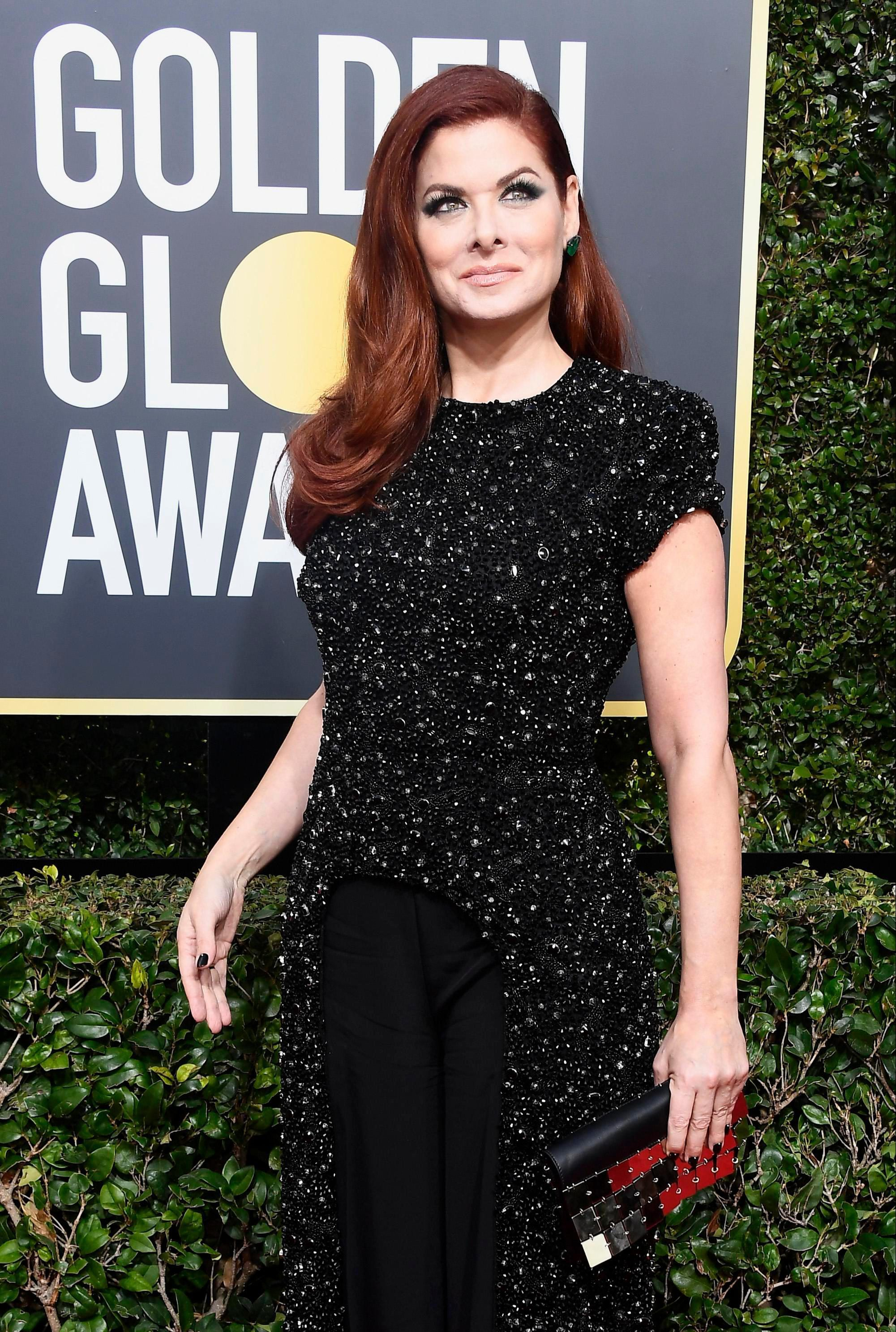 Debra Messing calls out E! for not paying female stars equally while live on E! at the Golden Globes