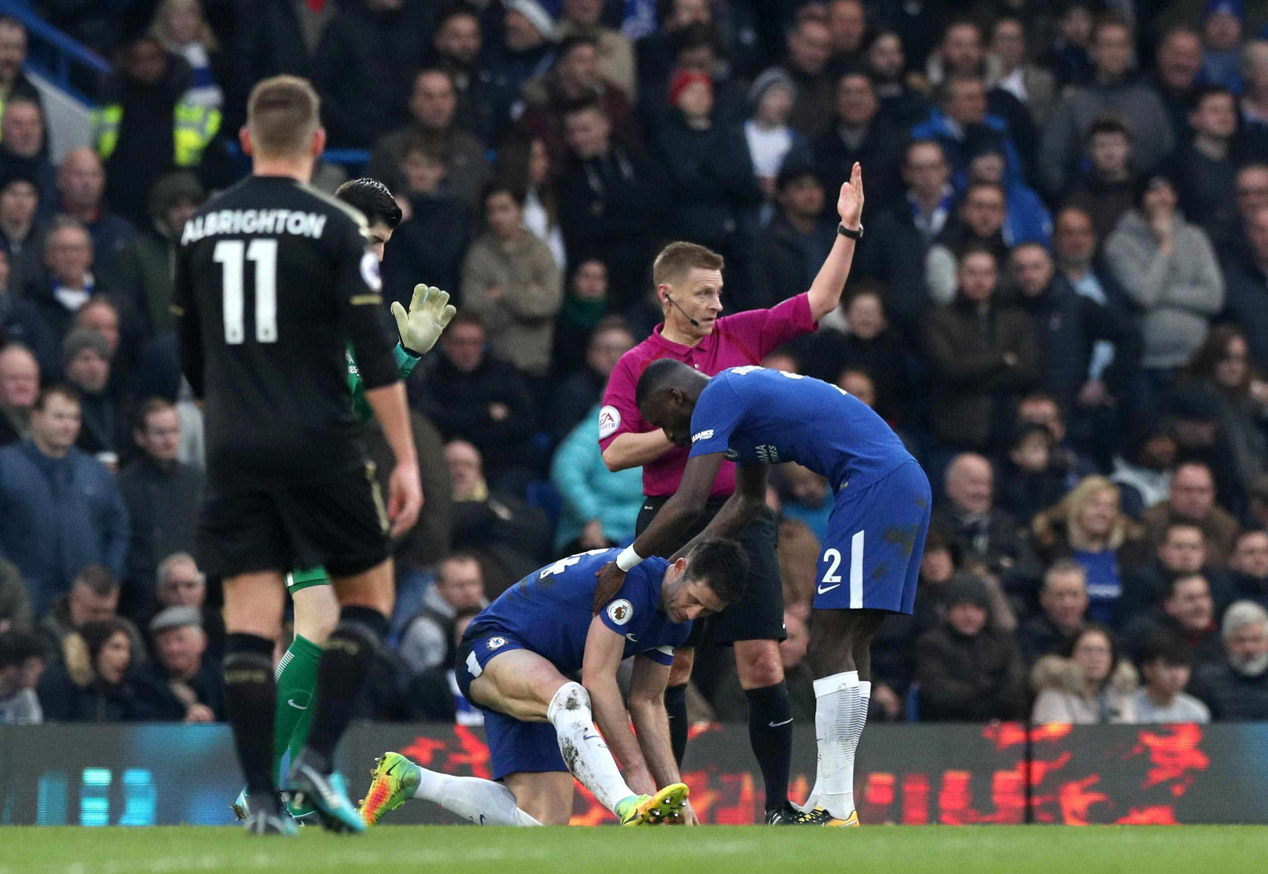 Chelsea star Gary Cahill taken off in the first-half against Leicester after picking up a hamstring injury