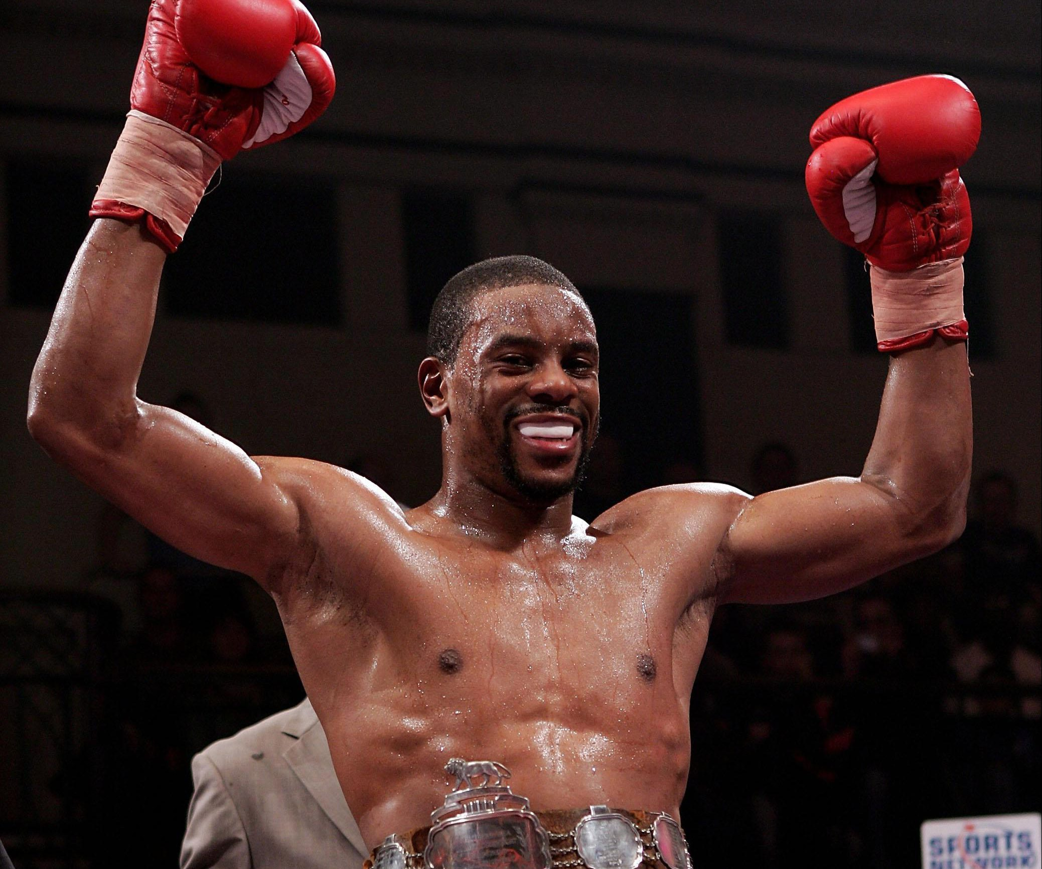 Former boxing champion Anthony Small charged with encouraging acts of terrorism