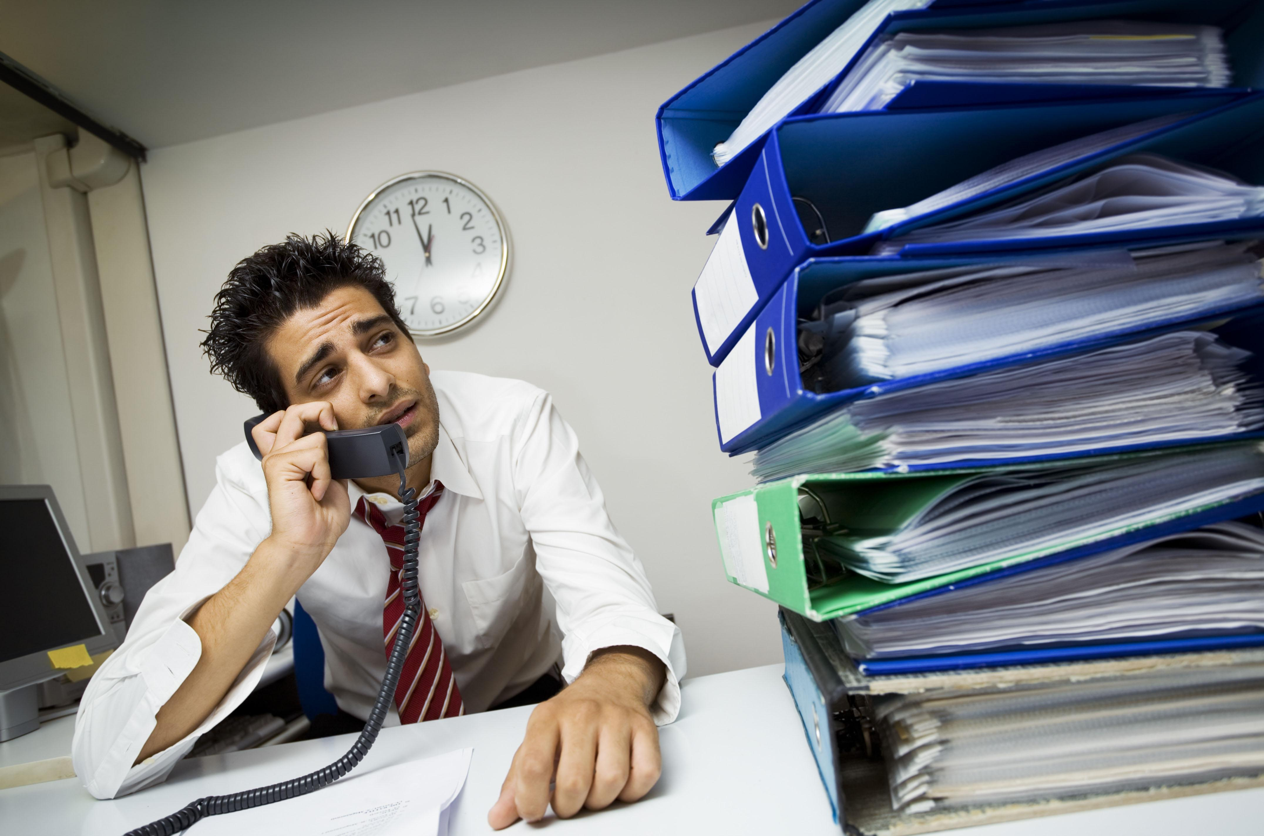 Millions of Brits 'overwhelmed' by heavy workload, busy social calendar and cash worries
