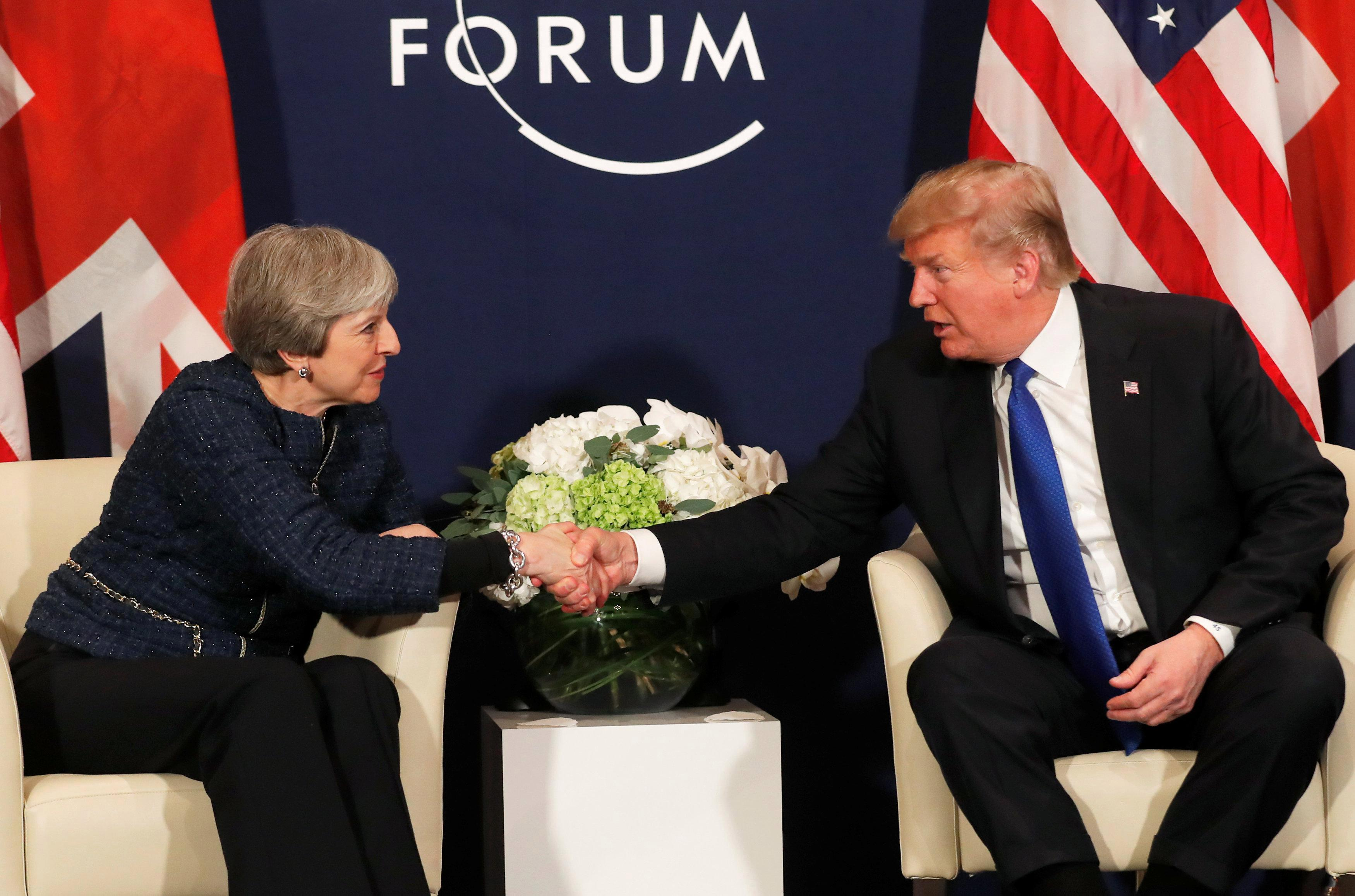 Donald Trump to 'talk' with Theresa May about when he will visit Britain on a state trip