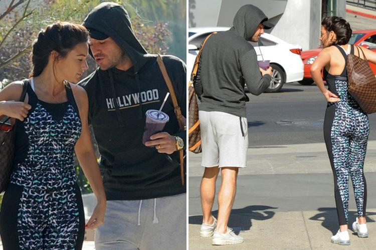 Mark Wright checks out wife Michelle Keegan's bum as they leave a posh gym in LA on New Year's Eve just hours before downing shots