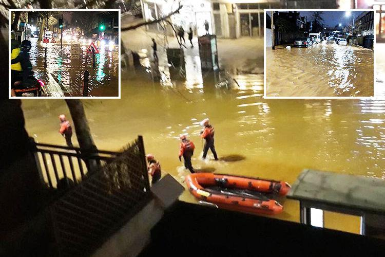 Dozens rescued from cars and homes by firefighters with BOATS after burst water main causes massive London flood