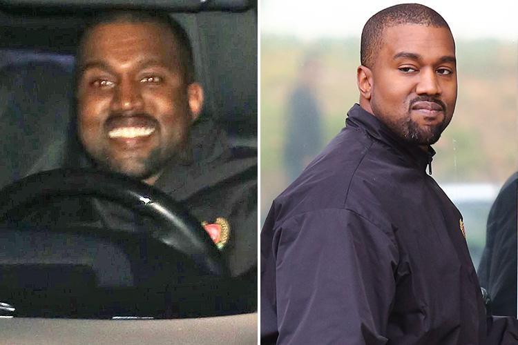 Kanye West can't stop smiling after the birth of his third child as a fan tries to congratulate him with boozy gift