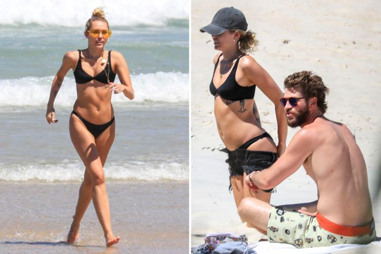 Miley Cyrus and Liam Hemsworth look loved-up as the singer strips off for a sizzling beach date in Australia