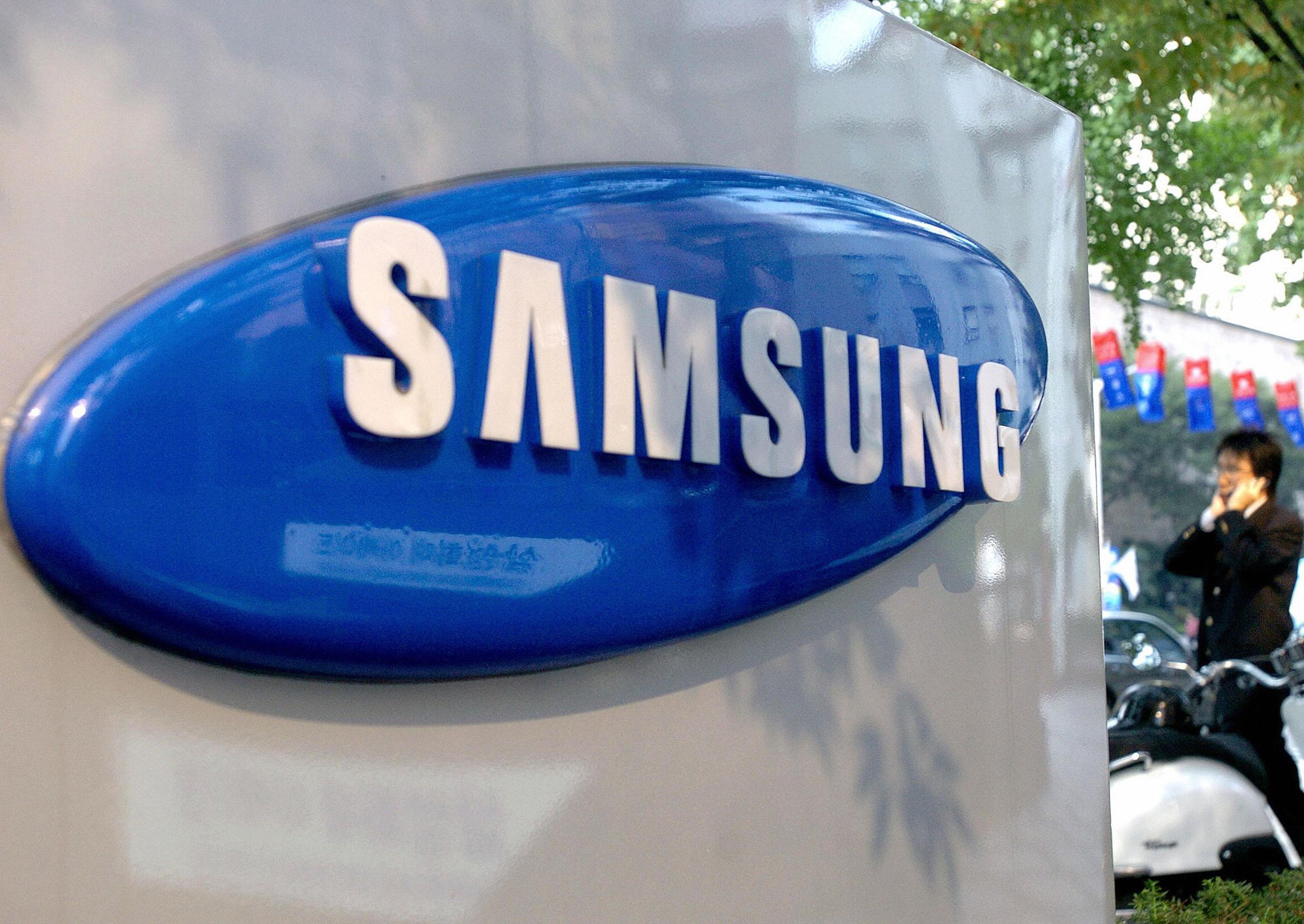 Samsung shares slip on lowered forecast
