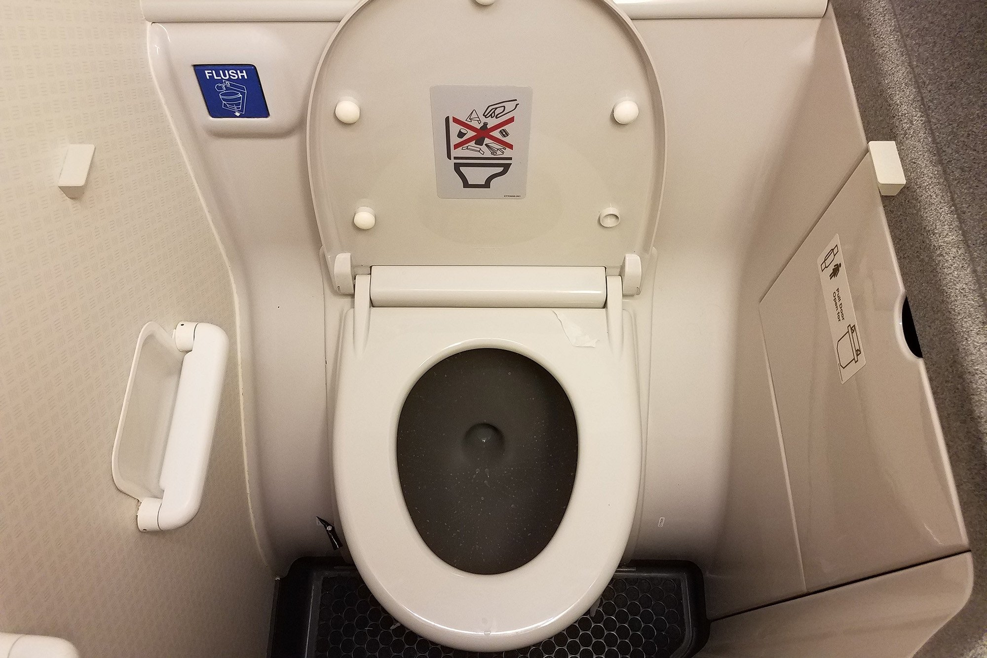 drunk man pees all over airplane bathroom, booted from flight