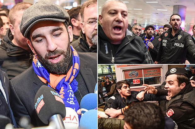 Police use teargas on rowdy Istanbul Basaksehir fans as they mob Arda Turan at airport ahead of transfer from Barcelona