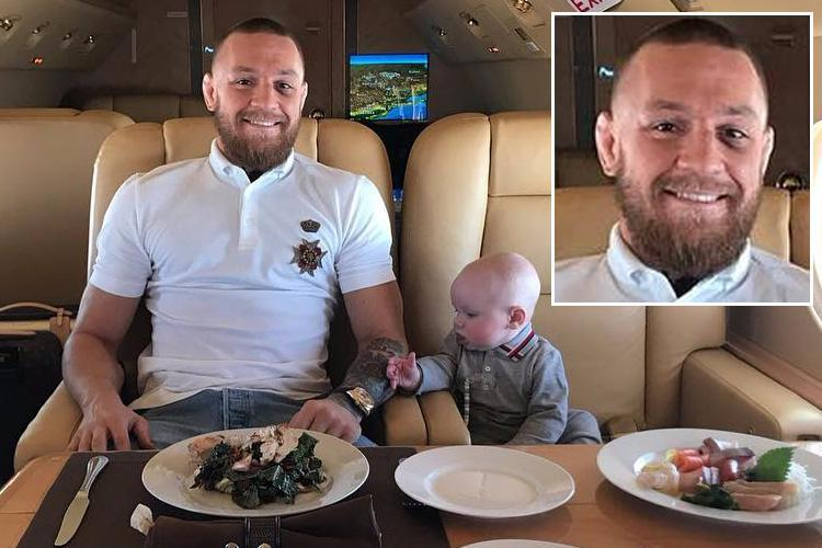 Conor McGregor sports black eye while enjoying dinner on private jet with Conor Jr