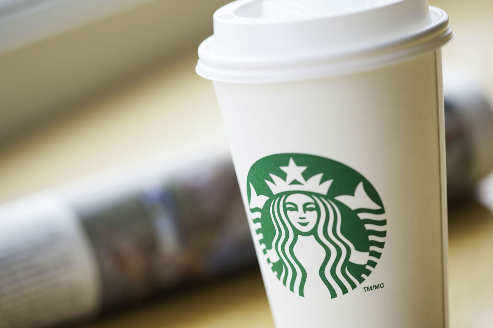 Starbucks begins testing fees for paper cups