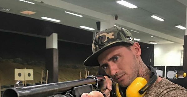 Stephen Bear points gun in Thailand