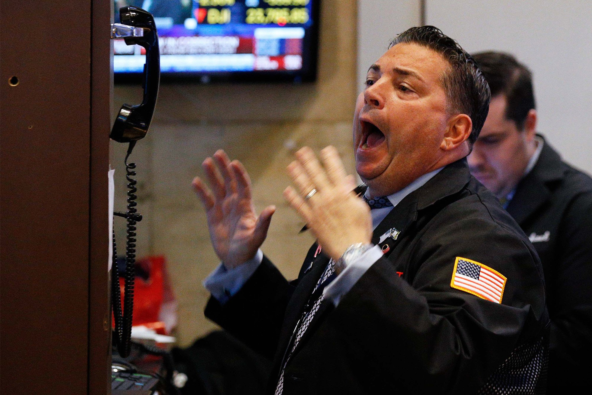 Dow rebounds to close up 560 points in wild trading session