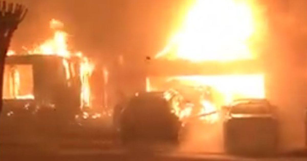 Ex-wife 'torches house she lost in divorce' but blaze spreads to 19 other homes