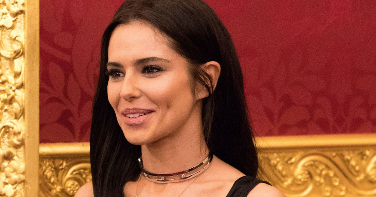 Cheryl shows off tiny waist in figure-hugging dress as she meets Prince Charles