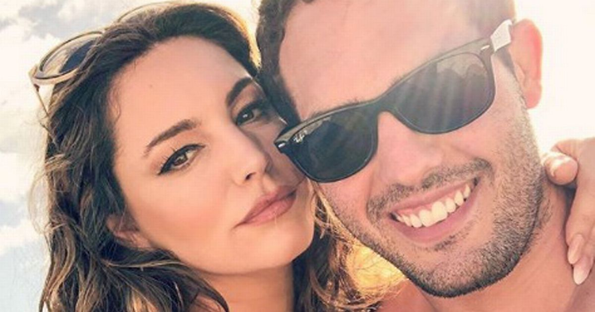 Kelly Brook poses in swimsuit on sun-drenched romantic holiday