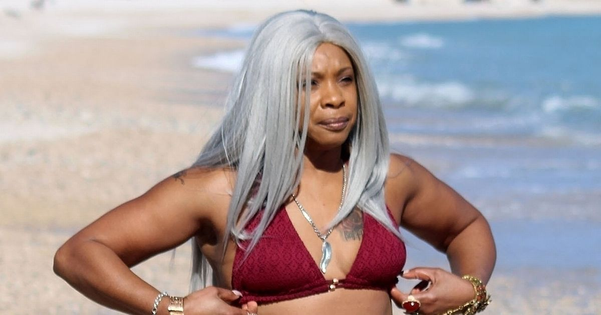 Sandi Bogle channels Kim Kardashian in tiny red bikini and platinum wig
