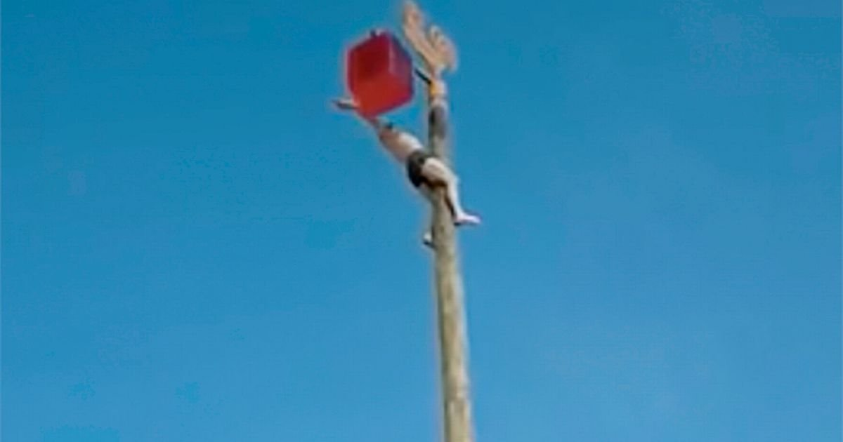 Near-naked man falls 23 feet from pole as he takes part in a festival