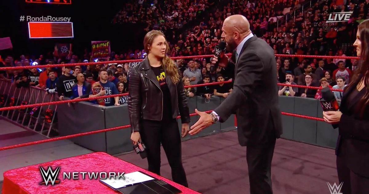 Ronda Rousey lives up to Rowdy nickname as she signs WWE contract