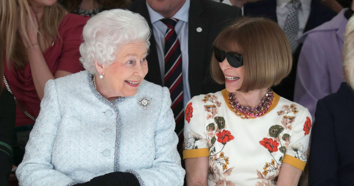 Queen beams with delight on front seat of London Fashion Week with Anna Wintour