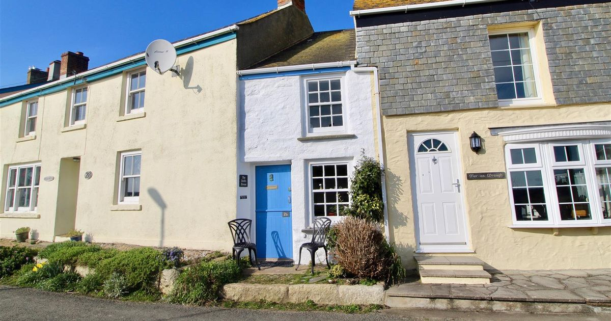 Inside Britain's 'narrowest home' which is back on the market at a lower price