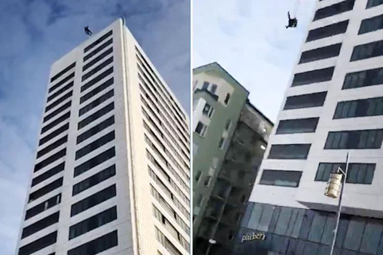 Heart-stopping moment base jumper plummets 24 storeys after his parachute fails – but miraculously SURVIVES