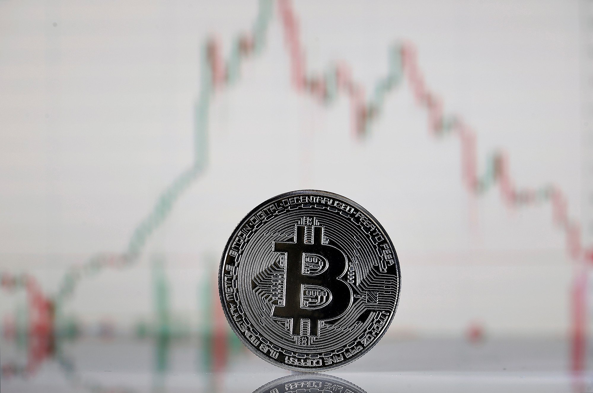 Bitcoin extends slide, tumbling more than 10 percent