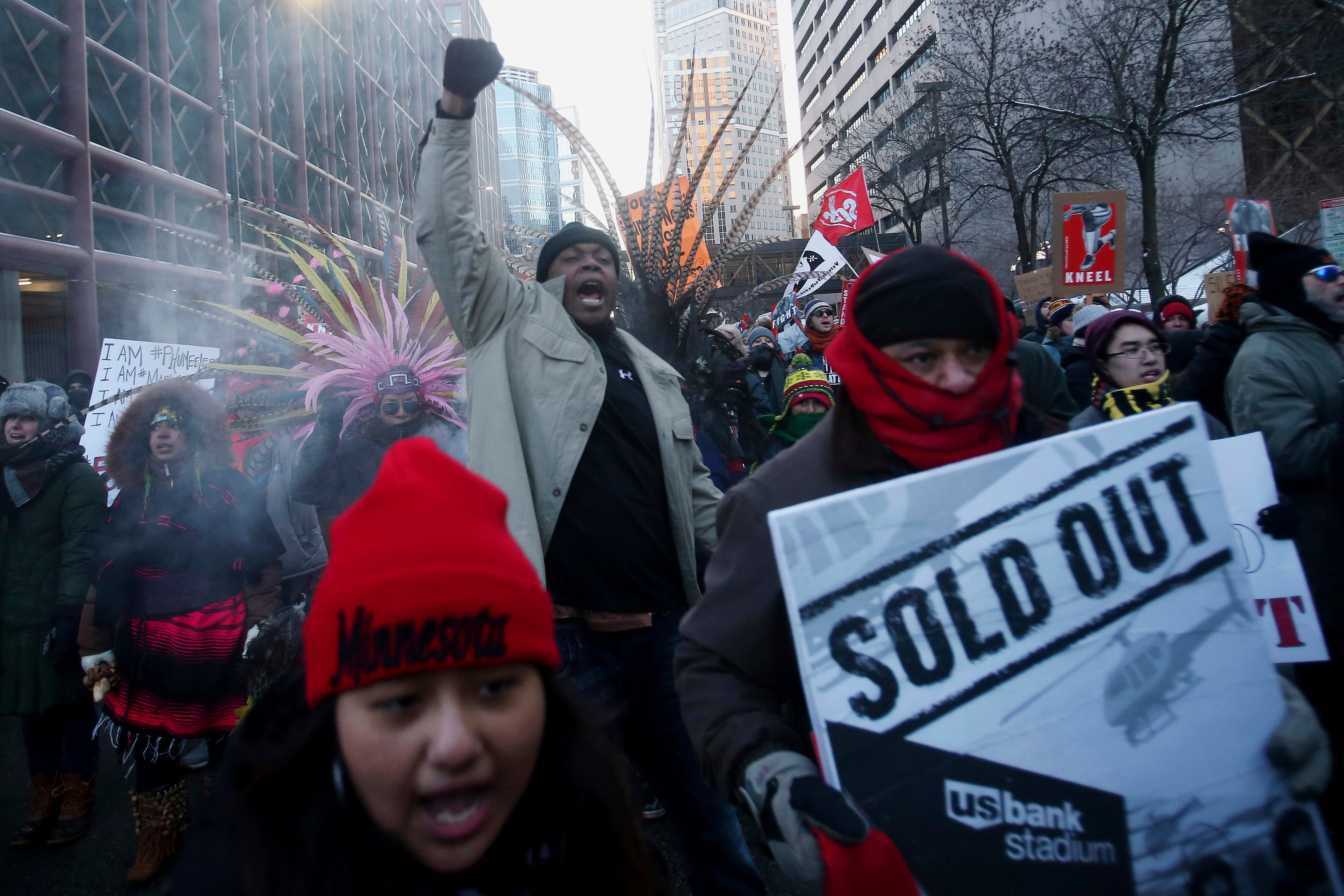 Chaos outside Super Bowl as protesters block trains