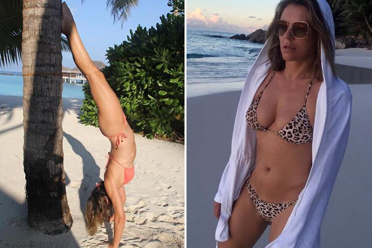 Elizabeth Hurley, 52, shows off her flexibility as she does a handstand on exotic beach