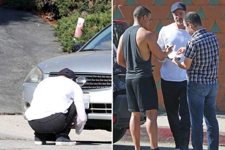 Brad Pitt involved in three-car crash in Los Angeles – as he's pictured swapping details with two other drivers