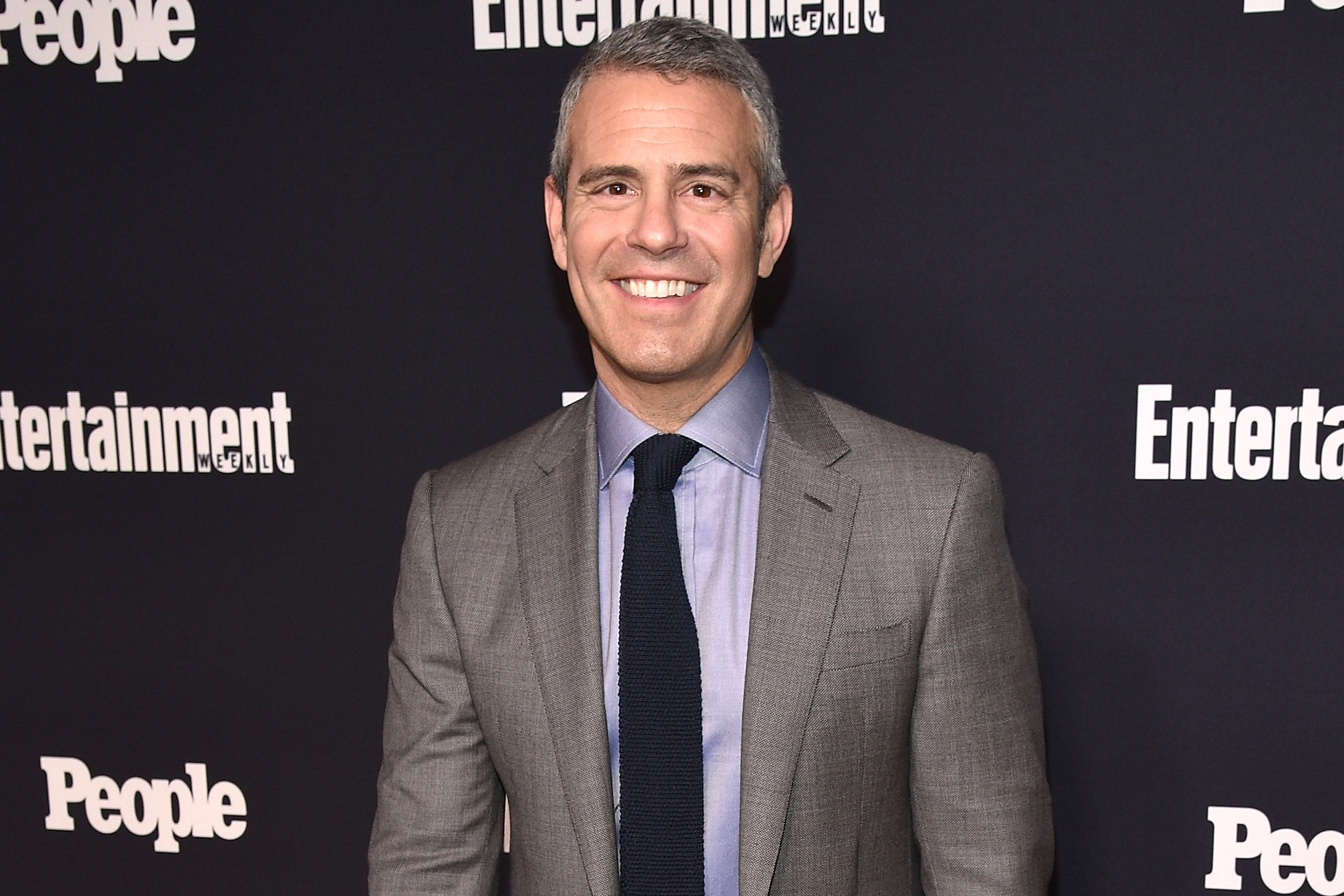 Watch Andy Cohen crash a live TV news broadcast