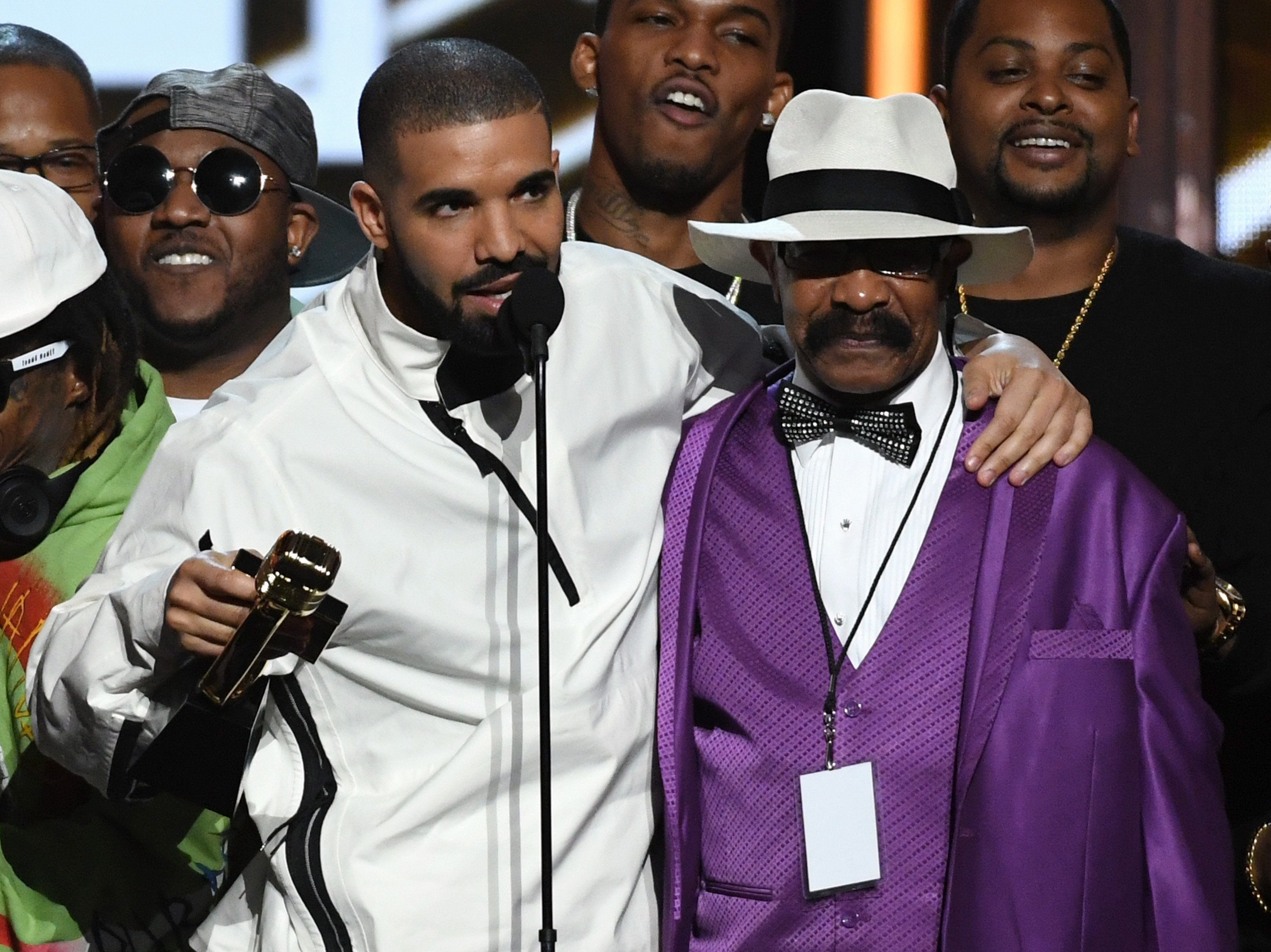Drake's dad has a suit line, and it is . . . snazzy