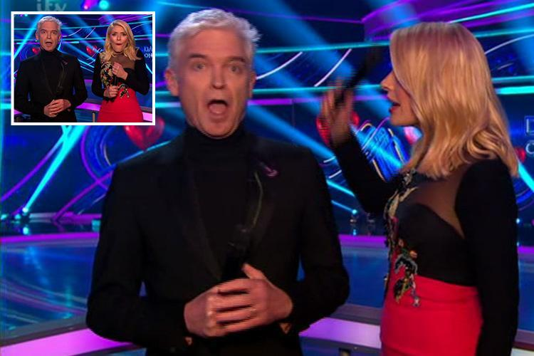 Holly Willoughby whacks Phillip Schofield over the head with a microphone as they use them throughout Dancing On Ice for first time