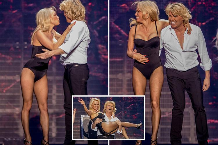 Pamela Anderson, 50, oozes sex appeal in a skintight leotard as she stars as a glamorous magician's assistant at a show in Berlin